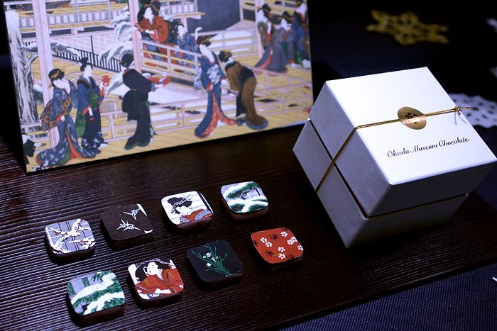 <フレーバー>(上段左から)①ゴルゴンゾーラチーズとベーコンチップ、②紫芋と黒胡麻、③和栗と松茸、④ピスタチオとシナモン、 (下段左から)⑤アーモンドミルクとドライアプリコット、⑥クリームチーズとベ リーローズ、⑦白トリュフと南瓜、⑧柚子とフレッシュバジル Okada Museum Chocolate『歌麿・深川の雪』