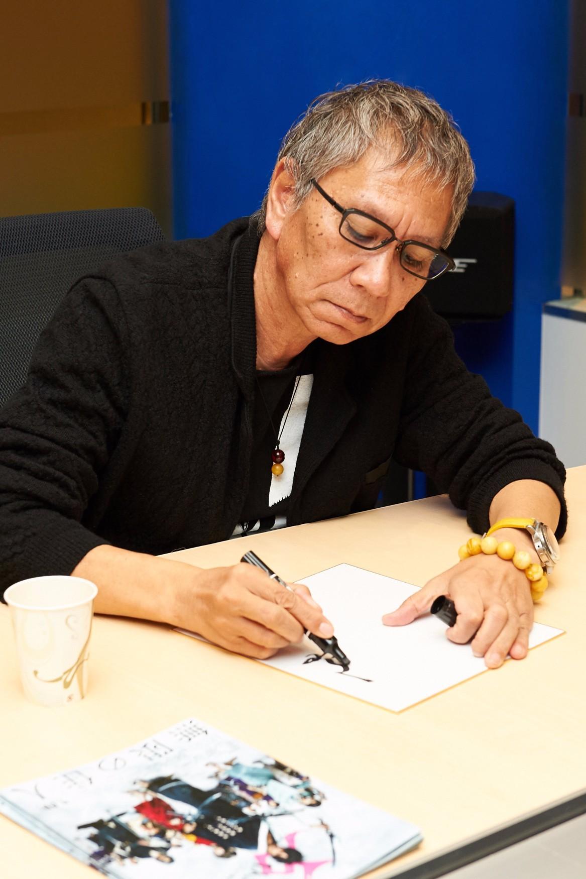 三池崇史監督 撮影=長井太一