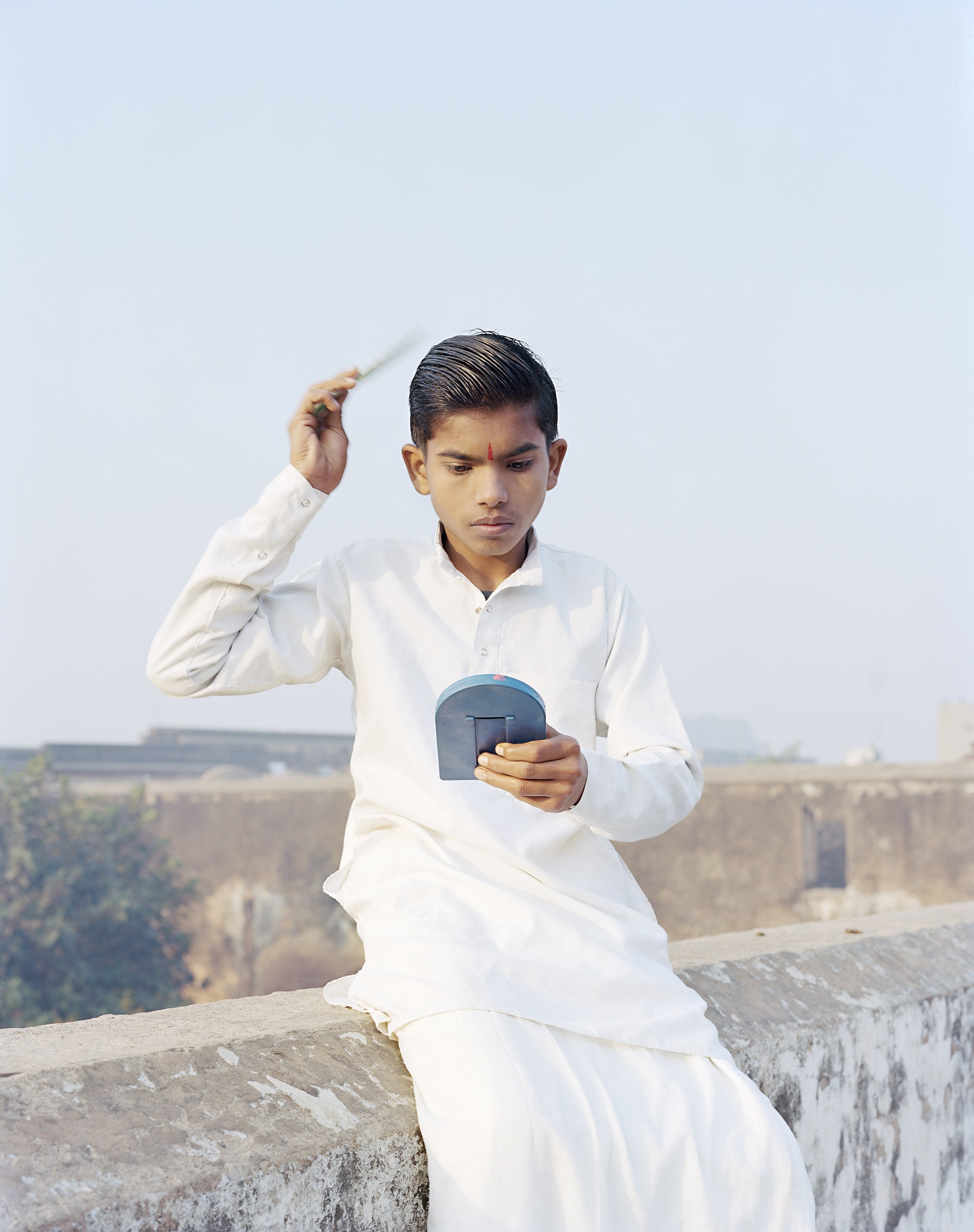Rama Combing His Hair, Ayodhya, India, 2015 (C)Vasantha Yogananthan
