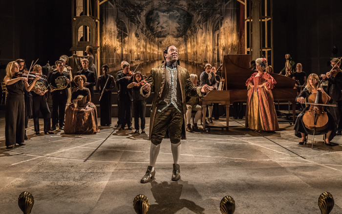 A scene from Amadeus, centre Lucian Msamati - Antonio Salieri (Image by Marc Brenner)