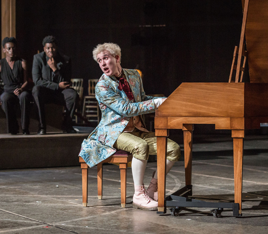 Adam Gillen - Wolfgang Amadeus Mozart, background Sarah Amankwah, Hammed Animashaun as Venticelli (image by Marc Brenner)
