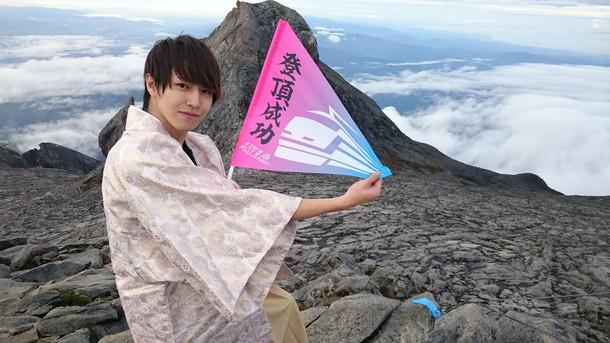 キナバル山登頂に成功したタカシ。